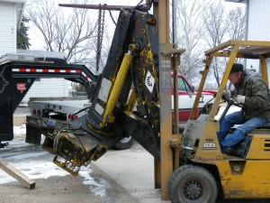 knuckleboom crane getting unloaded 2