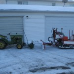 John Deere 110 and Miller Snow Dozer